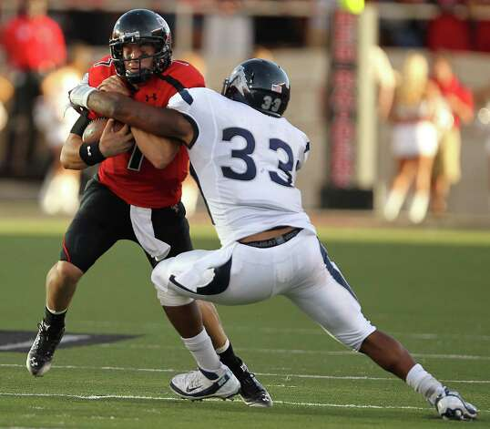Texas Tech's Seth Doege, left, is hit by Nevada's Brandon M. Marshall during an NCAA college football game at Jones AT&T Stadium in Lubbock, Texas, Saturday, Sept. 24, 2011.  (AP Photo/Lubbock Avalanche-Journal, Stephen Spillman) Photo: Stephen Spillman, Associated Press / Lubbock Avalanche-Journal