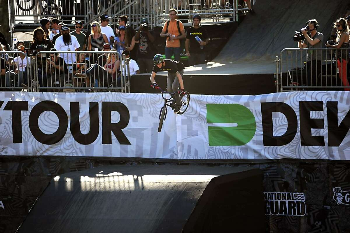 A rider drops into the BMX Dirt course during prelims. The 2012 Dew Tour Toyota City Champions are held at Civic Center Plaza in San Francisco, CA Thursday October 18th, 2012.