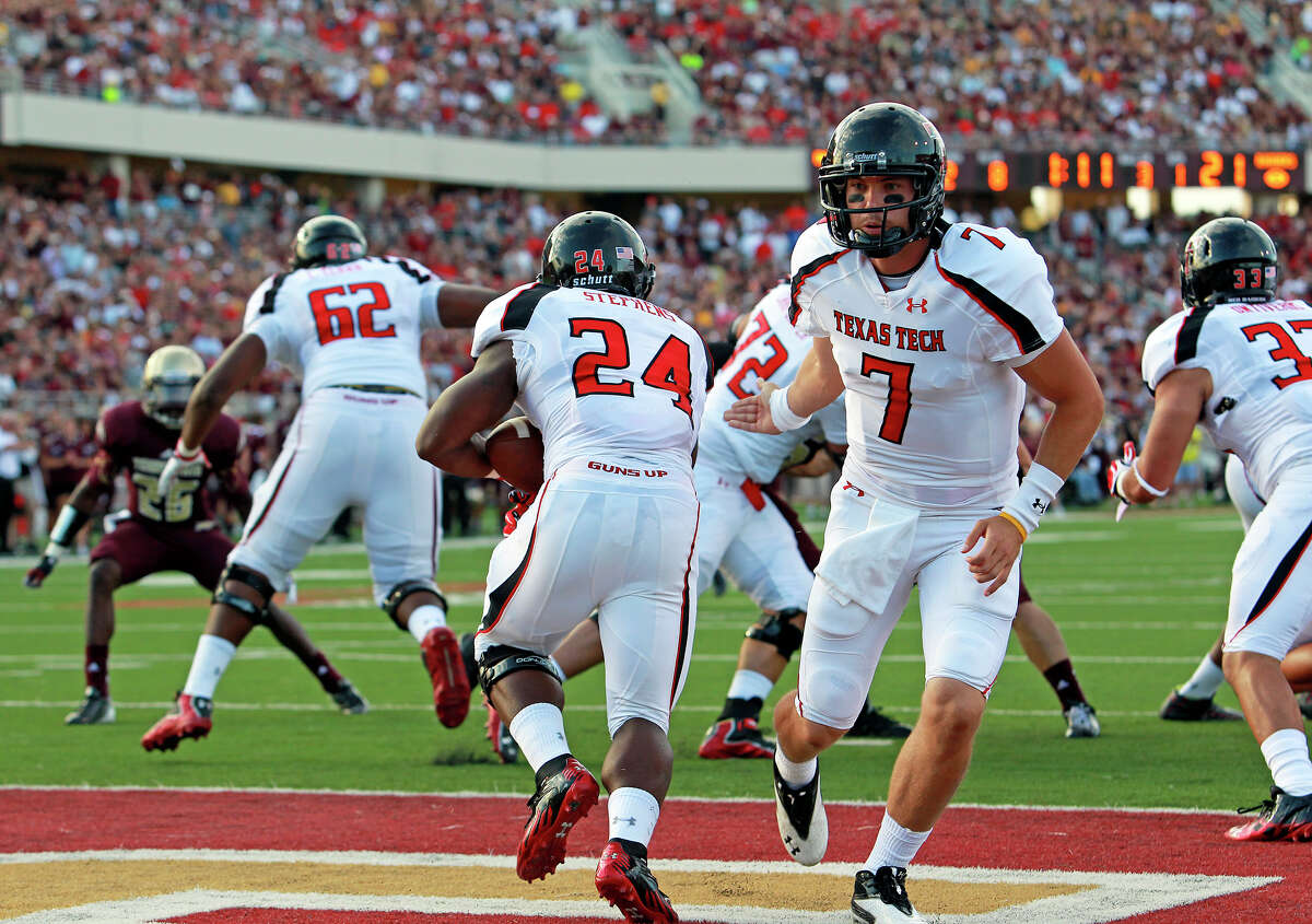Red Raiders quarterback Seth Doege hands off to his running back Eric Stephens as Texas State hosts Texas Tech at Bobcat Stadium on September 8, 2012.