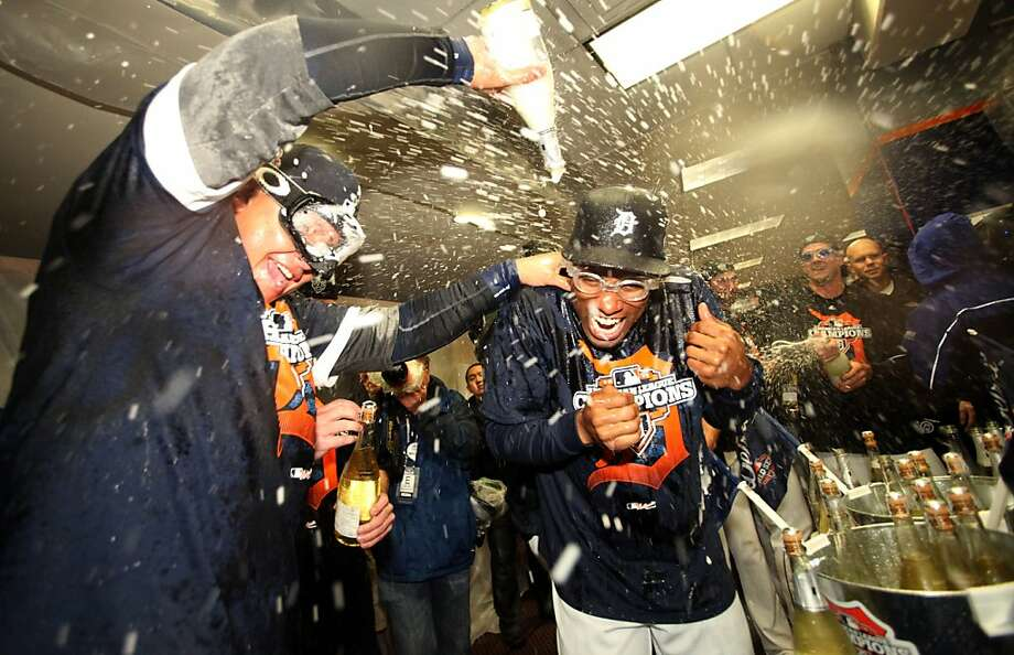 The Tigers' Miguel Cabrera (left) and Austin Jackson soak up a Champagne shower after their sweep of the Yankees. Photo: Julian H. Gonzalez, McClatchy-Tribune News Service