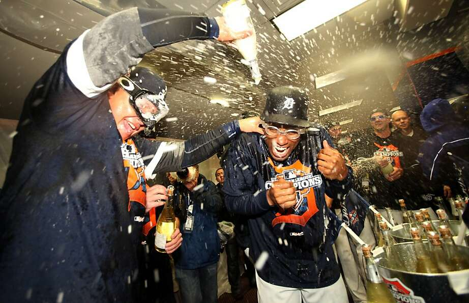 The Tigers' Miguel Cabrera (left) and Austin Jackson soak up a Champagne shower after their sweep of