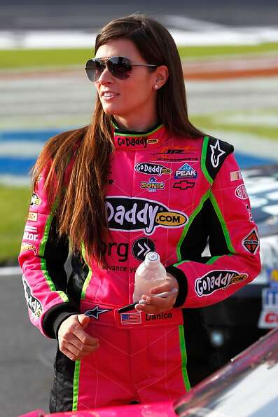 CHARLOTTE, NC - OCTOBER 12:  Danica Patrick, driver of the #7 GoDaddy.com Chevrolet, stands on the g