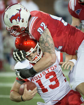 Houston backup quarterback Crawford Jones (13) is sacked by Southern Methodist defensive end Margus Hunt (92) during the second quarter of an NCAA college football game Thursday, Oct. 18, 2012, in Dallas. (AP Photo/Houston Chronicle, Smiley N. Pool) MANDATORY CREDIT Photo: Smiley N. Pool, Associated Press / Houston Chronicle