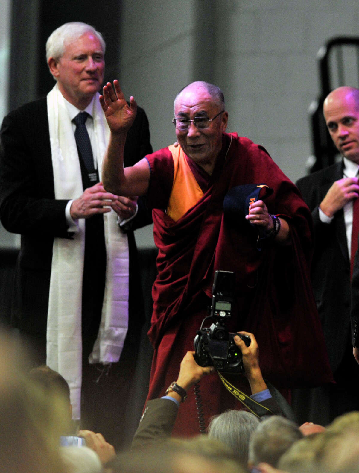The Dalai Lama waves to the crowd at the O'Neill Center on Western Connecticut State University's west side campus after his