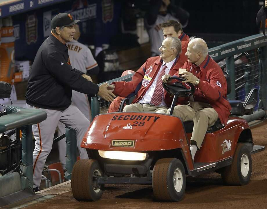 Stan Musial, 91, the Hall of Famer who played for the Cardinals, says hello to Bruce Bochy. Photo: Patrick Semansky, Associated Press