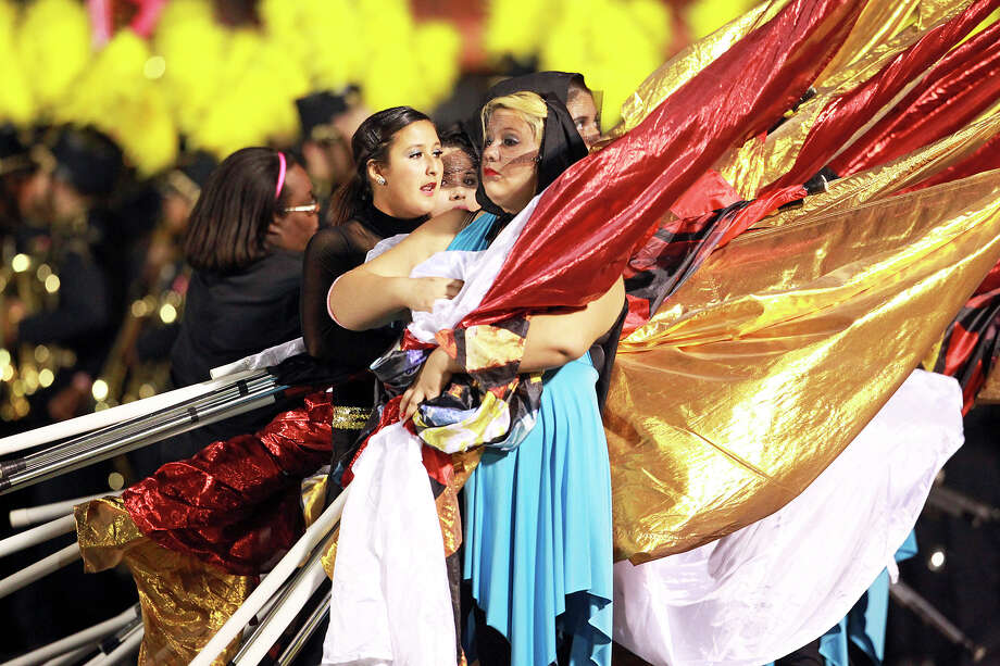 The Odyssey Color Guard waits to take the field at halftime as East Central hosts Southwest at East Central Stadium  on October 18, 2012. Photo: Tom Reel, Express-News / ©2012 San Antono Express-News