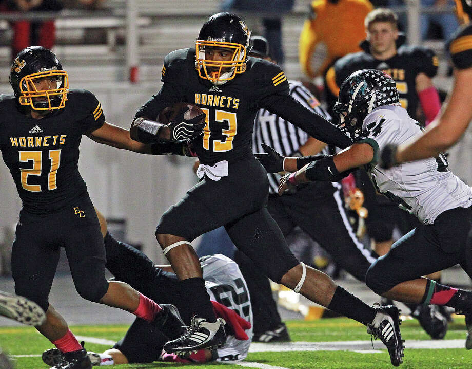 Hornet tailback Johnathan Jackson picks his way through tacklers on the right as East Central hosts Southwest at East Central Stadium  on October 18, 2012. Photo: Tom Reel, Express-News / ©2012 San Antono Express-News