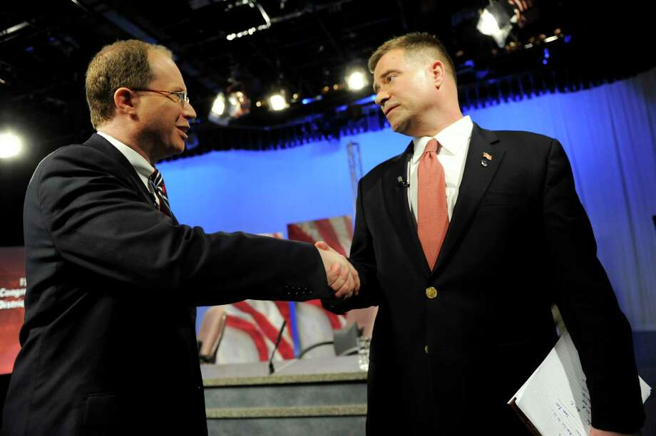 Challenger Julian Schreibman, left, and Rep. Chris Gibson shake hands following their debate for the 19th Congressional District on Thursday, Oct. 18, 2012, at WMHT Studios in North Greenbush, N.Y. (Cindy Schultz / Times Union) Photo: Cindy Schultz / 00019728A