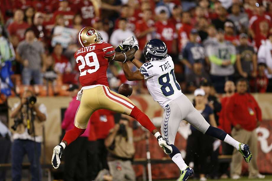 Cornerback Chris Culliver (29) and Seattle Seahawks wide receiver Golden Tate miss both miss the ball for an incomplete pass during the first quarter of the San Francisco 49ers game against the Seattle Seahawks at Candlestick Park in San Francisco, Calif., on Thursday October 18, 2012. Photo: Beck Diefenbach, Special To The Chronicle