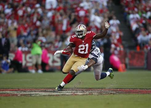 Running back Frank Gore (21) runs through an attempted tackle by Seattle Seahawks linebacker K.J. Wright (50) in the first half of the San Francisco 49ers game against the Seattle Seahawks at Candlestick Park in San Francisco, Calif., on Thursday October 18, 2012. Photo: Stephen Lam, Special To The Chronicle