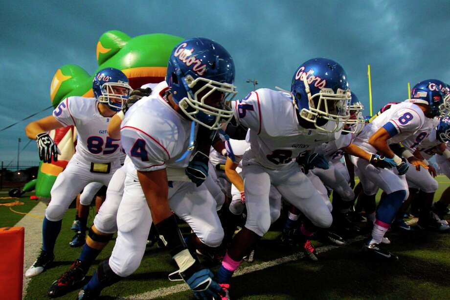 The Dickinson Gators get hyped up as they take the field against Clear Brook High school at CCISD Veterans Memorial Stadium, Thursday, Oct. 18, 2012, in League City. Photo: Billy Smith II, Houston Chronicle / © 2012 Houston Chronicle