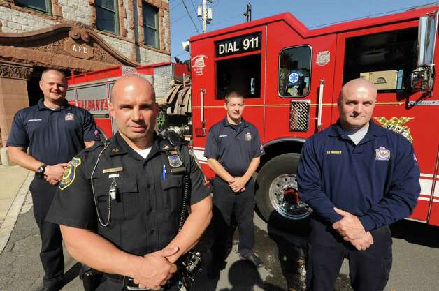 Left to Right, Albany firefighter Michael Prest, left, Albany Police Officer Michael Romano, Firefighter Ryan Frenca and Fire Lt. E.J. Seney at Engine One Fire House in  Albany,  NY Thursday Oct. 18, 2012. (Michael P. Farrell/Times Union) Photo: Michael P. Farrell