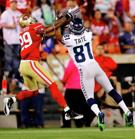 San Francisco 49ers cornerback Chris Culliver (29) breaks up a pass intended for Seattle Seahawks wide receiver Golden Tate (81) during the second quarter of an NFL football game in San Francisco, Thursday, Oct. 18, 2012. (AP Photo/Marcio Jose Sanchez) Photo: Marcio Jose Sanchez, Associated Press / AP