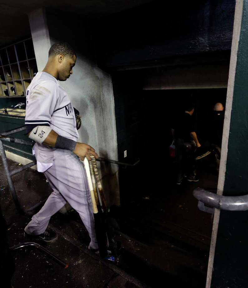 New York Yankees' Robinson Cano leaves the dugout after Game 4 of the American League championship series against the Detroit Tigers, Thursday, Oct. 18, 2012, in Detroit. The Tigers won 8-1 and moves on to the World Series. (AP Photo/Paul Sancya ) Photo: Paul Sancya