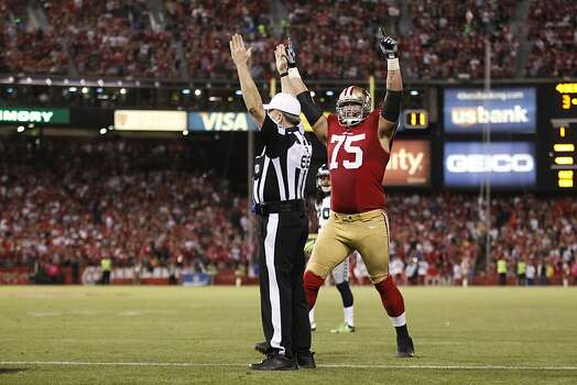 Offensive tackle Alex Boone (75) celebrates after a Delanie Walker  touchdown in the third quarter of the San Francisco 49ers game against the Seattle Seahawks at Candlestick Park in San Francisco, Calif., on Thursday October 18, 2012. Photo: Beck Diefenbach, Special To The Chronicle
