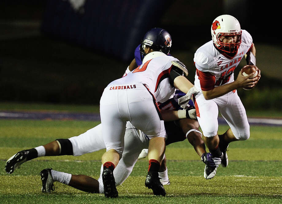 Lamar quarterback Caleb Berry is taken down in the back field during Northwestern State football game against Lamar University at Northwestern State University on Saturday, October 6, 2012. Photo taken: Randy Edwards/The Enterprise