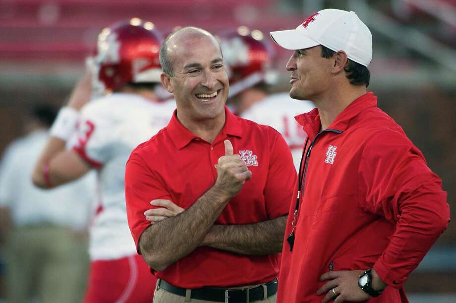 Houston head coach Tony Levine laughs with an assistant before an NCAA college football game against Southern Methodist at Ford Stadium, Thursday, Oct. 18, 2012, in Dallas. Photo: Smiley N. Pool, Houston Chronicle / © 2012  Houston Chronicle