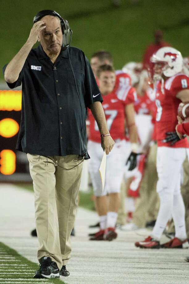 Southern Methodist head coach June Jones paces the sidelines during the second quarter of an NCAA college football game against Houston at Ford Stadium, Thursday, Oct. 18, 2012, in Dallas. Photo: Smiley N. Pool, Houston Chronicle / © 2012  Houston Chronicle