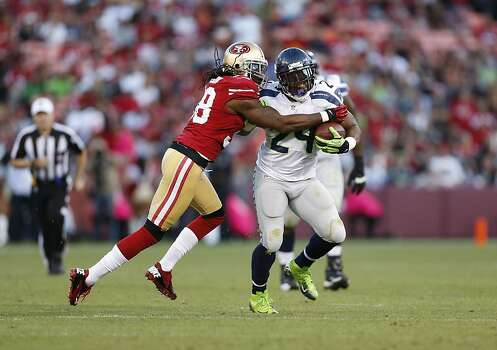 Seattle Seahawks running back Marshawn Lynch (24) is tackled by Safety Dashon Goldson (38) during the first half of the San Francisco 49ers game against the Seattle Seahawks at Candlestick Park in San Francisco, Calif., on Thursday October 18, 2012. Photo: Beck Diefenbach, Special To The Chronicle