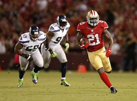 Frank Gore rambles for some of his 92 second-half rushing yards. For the game, he had a season-high 131, plus 51 on receptions. Photo: Beck Diefenbach, Special To The Chronicle