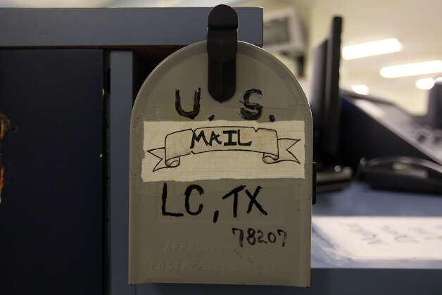 Personnel mark a mailbox for the retrofitted Special Observation Unit at the Bexar County Jail Thursday, Oct. 18, 2012. Bexar County Sheriff Amadeo Ortiz held a press conference on the latest modifications made at the jail in order to reduce suicide rates. The sheriff ordered an independent assessment by Lindsay M. Hayes, project director at the National Center on Institutions and Alternatives after inmate suicide rates rose. Among the eight critical improvements were staff training and identification and screening of inmates. Photo: JERRY LARA, San Antonio Express-News / © 2012 San Antonio Express-News