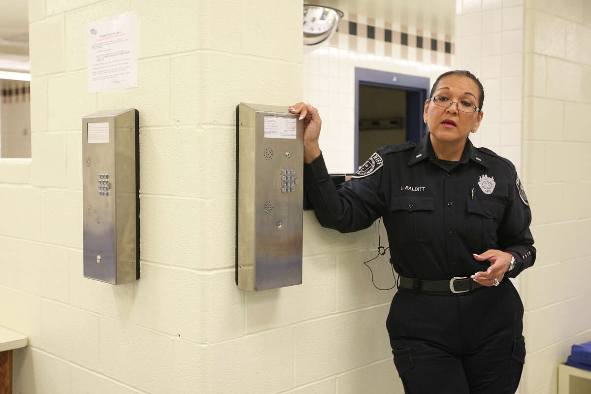 During a media tour of the retrofitted Special Observation Unit at the Bexar County Jail, Lt. Laura Balditt, (cq), talks about the cordless phones, Thursday, Oct. 18, 2012. Balditt announced Thursday April 5, that she is retiring, a day after the facility was found to be in non-compliance with a state commission.