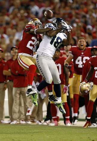 San Francisco 49ers cornerback Chris Culliver (29, left) breaks up a pass intended for Seattle Seahawks wide receiver Sidney Rice (18) during the fourth quarter of their NFL game at Candlestick Park on Thursday, October 18, 2012 in San Francisco, Calif. Photo: Beck Diefenbach, Special To The Chronicle