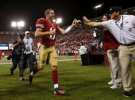 San Francisco 49ers quarterback Alex Smith (11) exits the field after defeating the Seattle Seahawks at Candlestick Park on Thursday, October 18, 2012 in San Francisco, Calif. Photo: Beck Diefenbach, Special To The Chronicle