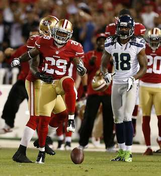 San Francisco 49ers cornerback Chris Culliver (29, left) celebrates after breaking up a pass intended for Seattle Seahawks wide receiver Sidney Rice (18) during the fourth quarter of their NFL game at Candlestick Park on Thursday, October 18, 2012 in San Francisco, Calif. Photo: Beck Diefenbach, Special To The Chronicle