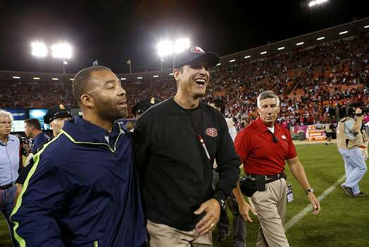San Francisco 49ers head coach Jim Harbaugh exits the field after defeating the Seattle Seahawks at Candlestick Park on Thursday, October 18, 2012 in San Francisco, Calif. Photo: Beck Diefenbach, Special To The Chronicle