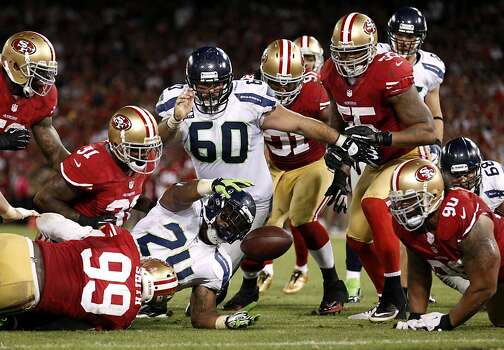 Seattle Seahawks running back Marshawn Lynch (24) recovers the ball after fumbling it during the fourth quarter of their NFL game at Candlestick Park on Thursday, October 18, 2012 in San Francisco, Calif. Photo: Beck Diefenbach, Special To The Chronicle