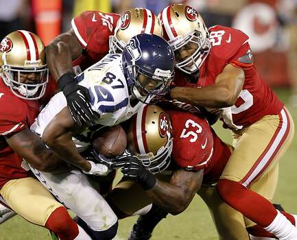 The 49ers defense swarmed around receiver Ben Obomanu in thefourth quarter. The San Francisco 49ers beat the Seattle Seahawks 13-6 in San Francisco, Calif at Candlestick Park, Photo: Brant Ward, The Chronicle