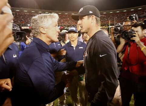 Seattle head coach Pete Carroll (left) met 49ers coach Jim Harbaugh after the game at midfield. The San Francisco 49ers beat the Seattle Seahawks 13-6 in San Francisco, Calif at Candlestick Park, Photo: Brant Ward, The Chronicle