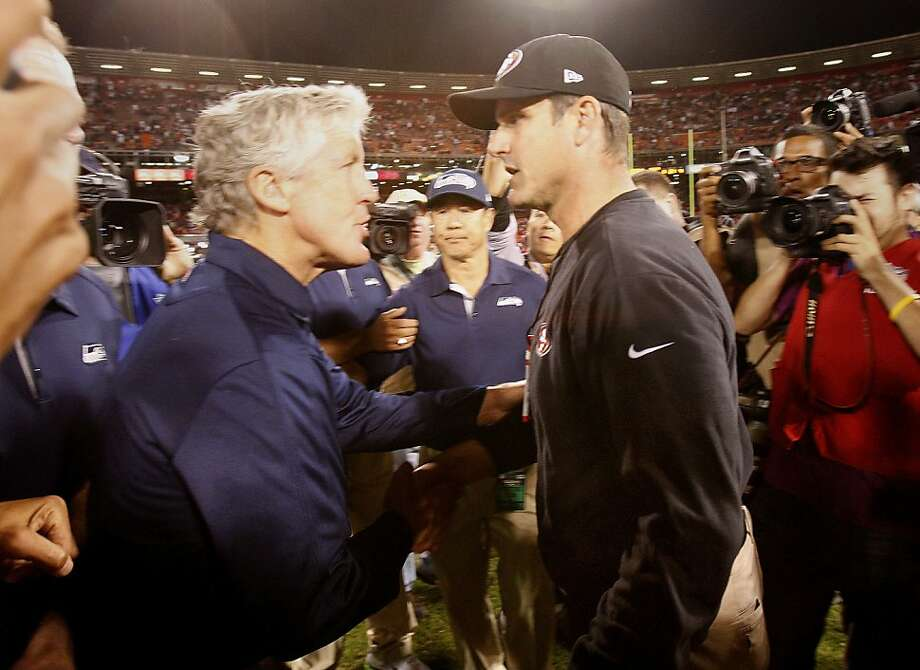 "There were no ""What's your deal?"" remarks when Seahawks head coach Pete Carroll met the 49ers' Jim Harbaugh at midfield after Thursday's game; bickering began later in interviews. Photo: Brant Ward, The Chronicle"