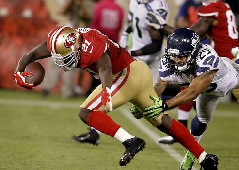 Frank Gore got a big gain in the fourth quarter running past Earl Thomas of the Seahawks. The San Francisco 49ers beat the Seattle Seahawks 13-6 in San Francisco, Calif at Candlestick Park, Photo: Brant Ward, The Chronicle