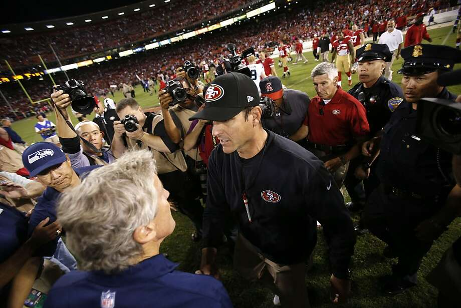 Jim Harbaugh and Pete Carroll had a civil greeting after San Francisco won at Candlestick on Oct. 18. The carping, at least from Harbaugh's side, came later. Photo: Stephen Lam, Special To The Chronicle