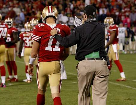 49ers coach Jim Harbaugh grabbed Alex Smith's jersey as he sent him back out in the fourth quarter. The San Francisco 49ers beat the Seattle Seahawks 13-6 in San Francisco, Calif at Candlestick Park, Photo: Brant Ward, The Chronicle