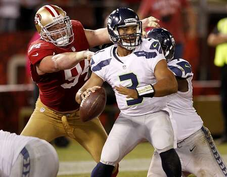 The 49ers Justin Smith (94) had constant pressure on Seattle quarterback Russell Wilson. The San Francisco 49ers beat the Seattle Seahawks 13-6 in San Francisco, Calif at Candlestick Park, Photo: Brant Ward, The Chronicle
