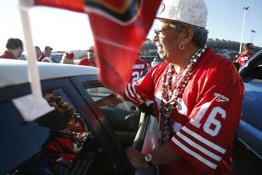 Ray Martinez, a 49ers season ticket holder since the team's move to Candlestick park, reaches for a jacket before a game against Seattle Seahawks at Candlestick Park in San Francisco, Calif., on Thursday October 18, 2012. Photo: Stephen Lam, Special To The Chronicle