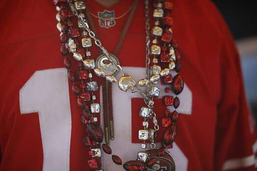 Ray Martinez, a 49ers season ticket holder since the team's move to Candlestick park, wear football necklaces before a game against Seattle Seahawks at Candlestick Park in San Francisco, Calif., on Thursday October 18, 2012. Photo: Stephen Lam, Special To The Chronicle