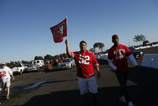 Adrian Ybarra, of Tracy,  waves a flag in the parking lot before a game against Seattle Seahawks at Candlestick Park in San Francisco, Calif., on Thursday October 18, 2012. Photo: Stephen Lam, Special To The Chronicle