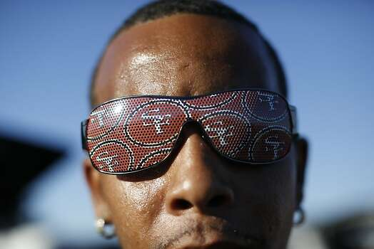 Timothy Jimmerson, of Fairfield, display a 49ers sunglasses before a game between the San Francisco 49ers and visiting Seattle Seahawks at Candlestick Park in San Francisco, Calif., on Thursday October 18, 2012. Photo: Stephen Lam, Special To The Chronicle