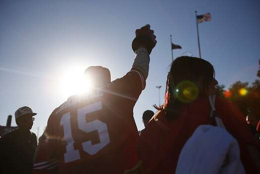 Joshua Torrez, of San Jose, waves a foam finger before a game between the San Francisco 49ers and visiting Seattle Seahawks at Candlestick Park in San Francisco, Calif., on Thursday October 18, 2012. Photo: Stephen Lam, Special To The Chronicle