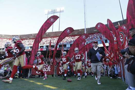 49ers Guard Daniel Kilgore (67), Defensive tackle Ricky Jean Francois (95) and team take the field to play the Seattle Seahawks at Candlestick Park in San Francisco, Calif., on Thursday October 18, 2012. Photo: Beck Diefenbach, Special To The Chronicle