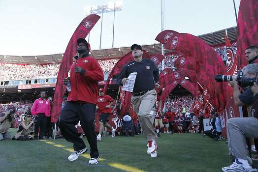 49ers coach Jim Harbaugh takes the field to lead the 49ers against the Seattle Seahawks at Candlestick Park in San Francisco, Calif., on Thursday October 18, 2012. Photo: Beck Diefenbach, Special To The Chronicle