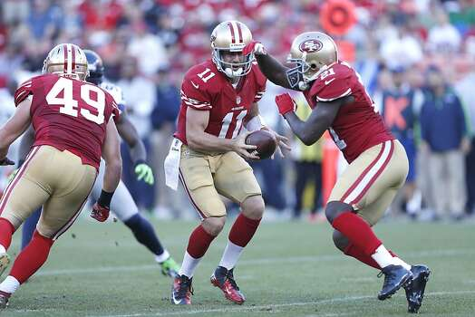 49ers Quarterback Alex Smith (11) hands off the ball to Running back Frank Gore (21) during the first quarter of the San Francisco 49ers game against the Seattle Seahawks at Candlestick Park in San Francisco, Calif., on Thursday October 18, 2012. Photo: Beck Diefenbach, Special To The Chronicle
