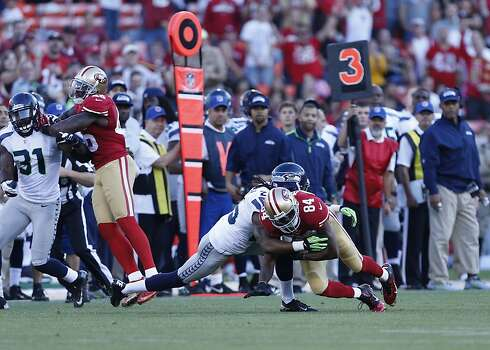 Wide receiver Randy Moss (84) is brought down during the first quarter of the San Francisco 49ers game against the Seattle Seahawks at Candlestick Park in San Francisco, Calif., on Thursday October 18, 2012. Photo: Beck Diefenbach, Special To The Chronicle