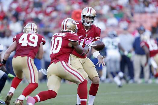 49ers Quarterback Alex Smith (11) passes the ball to Wide receiver Kyle Williams (10)  during the first quarter of the San Francisco 49ers game against the Seattle Seahawks at Candlestick Park in San Francisco, Calif., on Thursday October 18, 2012. Photo: Beck Diefenbach, Special To The Chronicle