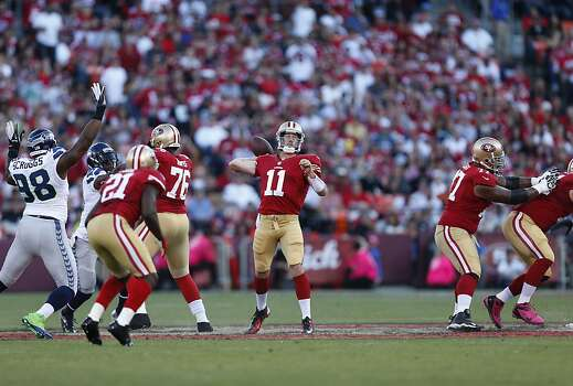 Quarterback Alex Smith (11) looks to throw downfield  during the first quarter of the San Francisco 49ers game against the Seattle Seahawks at Candlestick Park in San Francisco, Calif., on Thursday October 18, 2012. Photo: Beck Diefenbach, Special To The Chronicle