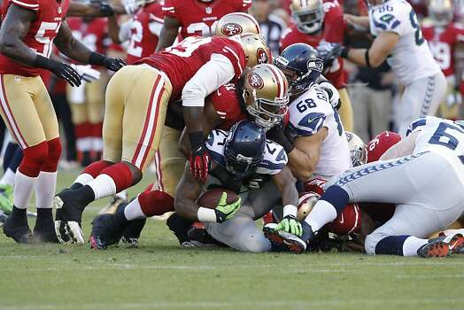 Seattle Seahawks running back Marshawn Lynch (24) only gains 2 yards on his first cary as a Seahawk during the San Francisco 49ers game against the Seattle Seahawks at Candlestick Park in San Francisco, Calif., on Thursday October 18, 2012. Photo: Brant Ward, The Chronicle